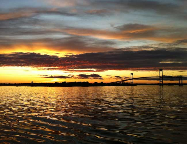 Rose Island and Newport Bridge on sunset sail boat tour